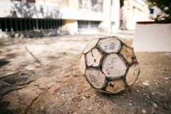 Soccer ball, football. Old and shabby soccer ball Stock Photo