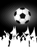 Soccer ball (football) with silhouettes of fans Stock Photo