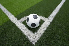Soccer ball or football on soccer field background Stock Photography