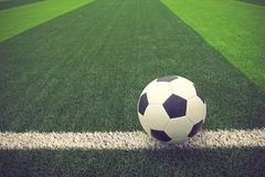 Soccer ball or football on soccer field vintage color Royalty Free Stock Photos