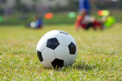 Soccer ball on the football stadium Stock Photography