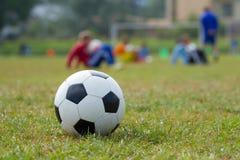 Soccer ball on the football stadium Stock Photos