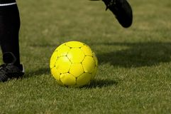 Soccer Ball - Football Yellow. Yellow Soccer - Football getting kicked royalty free stock photography