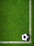 Soccer ball framed by white marking lines top view Royalty Free Stock Photography