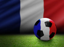 Soccer ball with france flag on the soccer field Royalty Free Stock Photo