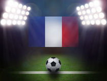 Soccer Ball with France Flag in stadium. Royalty Free Stock Image