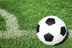 Soccer ball on fresh green football field grass. Space for text stock image