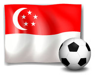 A soccer ball in front of the flag of Singapore Stock Photo