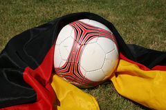 Soccer ball in front of a german flag. Soccer ball in front of the german flag royalty free stock photos