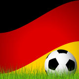 Soccer ball in front of german flag Stock Photography