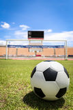 A soccer ball in front of goal. On the grass Royalty Free Stock Image