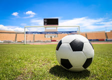 A soccer ball in front of goal. On the grass Royalty Free Stock Photos