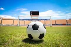 A soccer ball in front of goal. On the grass Royalty Free Stock Photography
