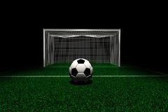 Soccer ball in front goal Royalty Free Stock Image