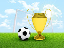 Soccer ball, gate and gold cup in the field Royalty Free Stock Photography