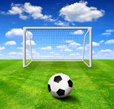Soccer ball with gate. On grass Royalty Free Stock Photo