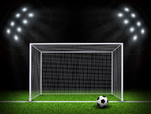 Soccer ball and gate in the middle of field Royalty Free Stock Photography