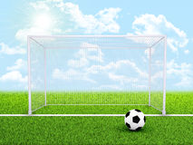 Soccer ball and gate in the middle of field Stock Image