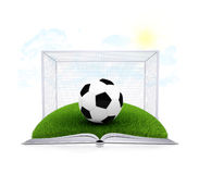Soccer ball and gate on an open white book Royalty Free Stock Image