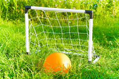 Soccer ball and gate. Toys on the field of stadium Royalty Free Stock Photos