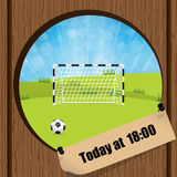 Soccer ball and gate in wooden fence hole Royalty Free Stock Images