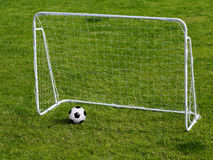 Soccer ball in gates Royalty Free Stock Image