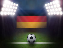 Soccer Ball with German Flag in stadium. Royalty Free Stock Photos