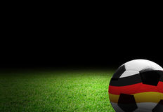 Soccer ball with germany flag on the soccer field. With copy space Royalty Free Stock Photography