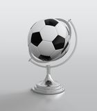 Soccer ball globe Stock Images