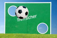Soccer ball and goal. A soccer or football goal with a soccer ball suspended in the foreground Royalty Free Stock Photos