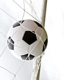 A soccer ball in the goal Royalty Free Stock Image