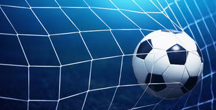 Soccer ball in goal. On blue background royalty free stock images