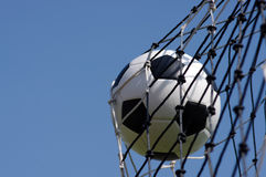 Soccer ball. In goal and blue sky Royalty Free Stock Photo