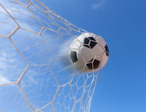 Soccer ball in goal. With blue sky Royalty Free Stock Images