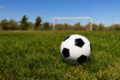 Soccer Ball with a Goal at a Field Royalty Free Stock Photography