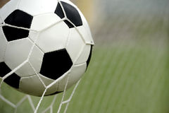 Soccer ball in goal Royalty Free Stock Photo