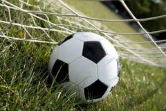 Soccer Ball. Goal in grass stock photography