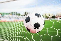 Soccer ball in the goal net Stock Images