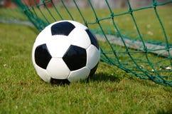 Soccer ball. In the goal net Stock Images