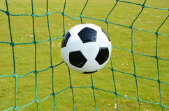 Soccer ball. In the goal net Royalty Free Stock Images