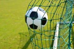 Soccer ball. In the goal net Stock Photos