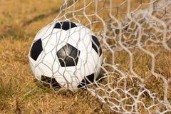 Soccer ball in goal Royalty Free Stock Photos