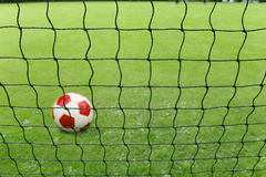 Soccer ball and goal net Royalty Free Stock Photos
