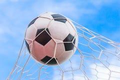 Soccer ball in goal net Stock Photo