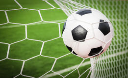 Soccer ball in the goal net Royalty Free Stock Photo