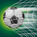 Soccer ball in goal net Royalty Free Stock Images