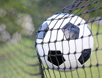 Soccer ball in goal net. Football Royalty Free Stock Photo