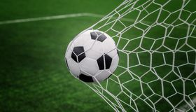 Soccer ball on goal with net and green background. This photo can use for football, sport, goal, score, shoot and target of business concept royalty free stock photo