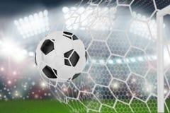 Soccer ball in goal net Royalty Free Stock Photo