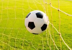 Soccer ball in goal net Royalty Free Stock Image